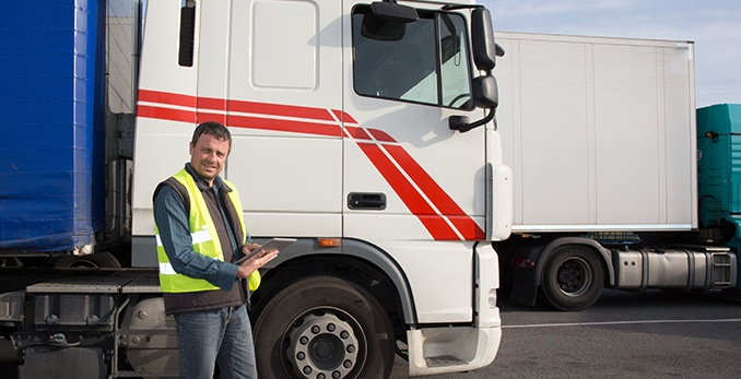 An inspector standing outside of a truck conducting a vehicle-only inspection
