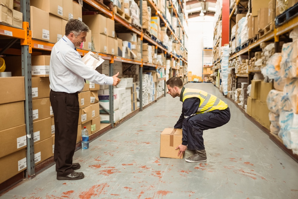 Manager watching worker carrying boxes in a large manufacturing warehouse, employee observation, bbs